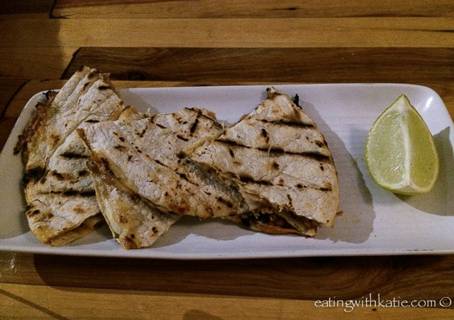 Pulled pork quesadilla with chipotle, orange, cheese and lime $14